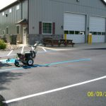 Paint sprayer for parking lot lines